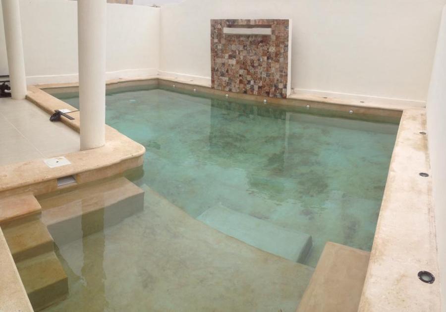 Foto alberca chukum con cascada de piscinas m rida 60807 for Construccion de piscinas merida