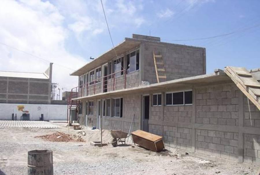 Foto construcci n de m dulos de oficinas cemex concretos for Construccion de modulos comerciales