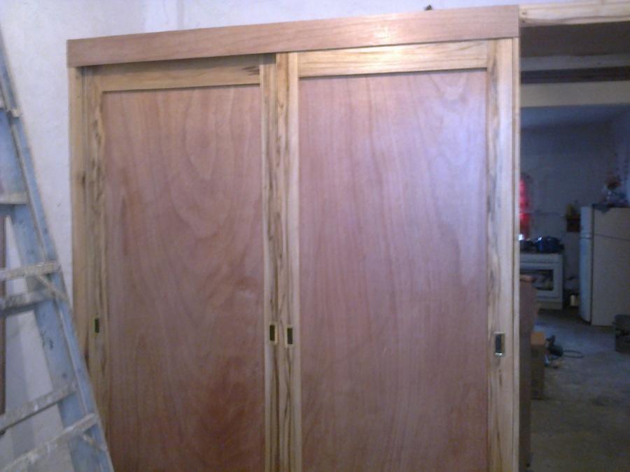 Foto closet de madera de cedro de acabados de for California closets mexico