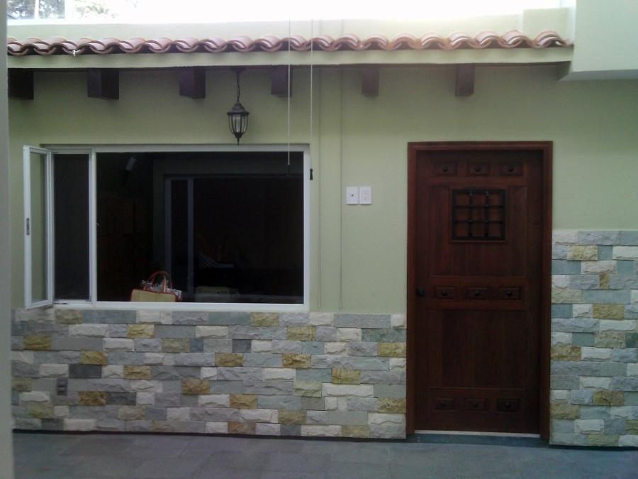 Foto fachada de roca y m s 9913 habitissimo for Losetas para fachadas