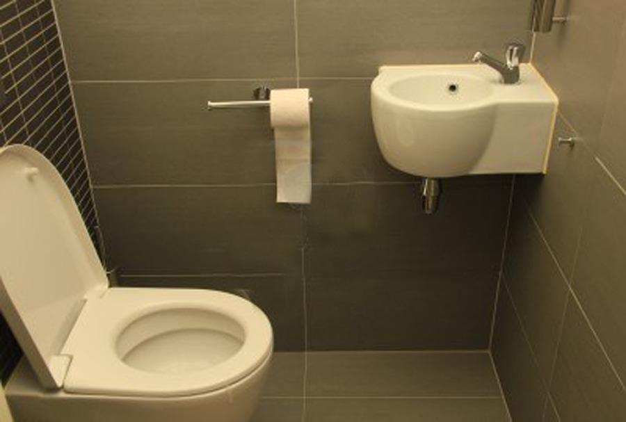 Medio Baño Minimalista:Medio baño acabado en