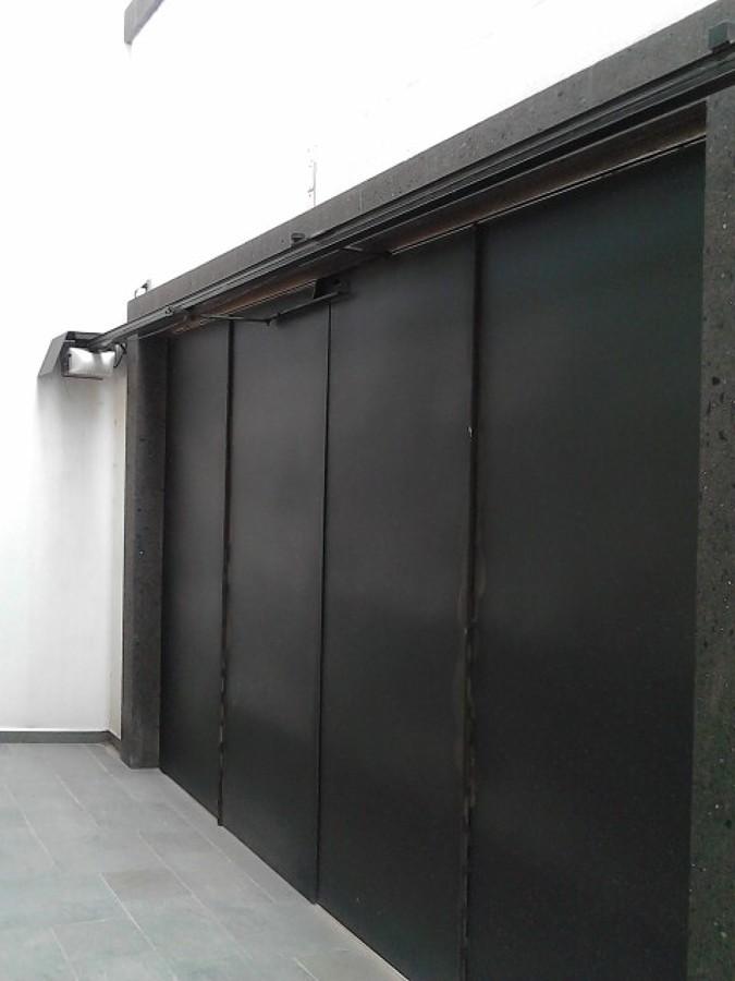Foto port n 4 hojas de mcdin 51587 habitissimo for Zaguan de casas modernas