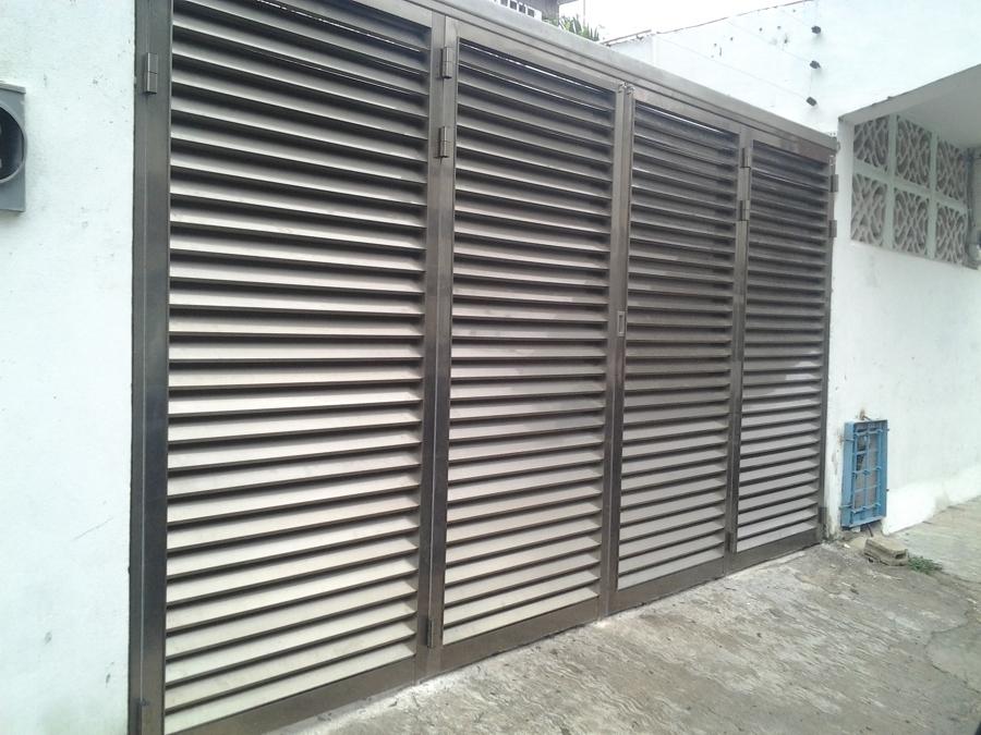 Foto puerta de garage plegable de aluminios de quintana - Puertas para cocheras ...