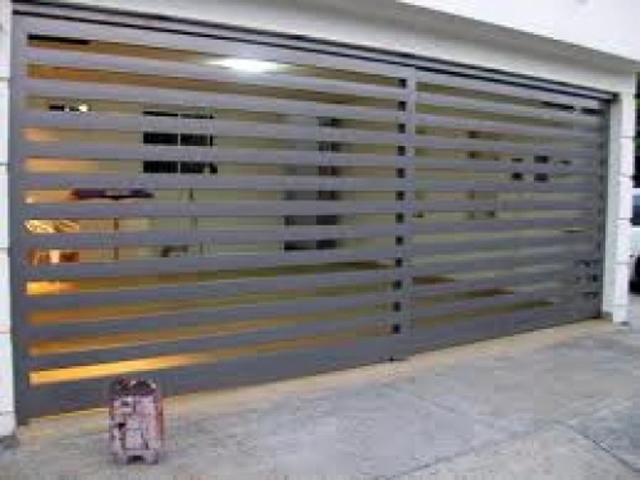 Foto puertas automaticas de star solar solutions sa de for Garajes automaticos