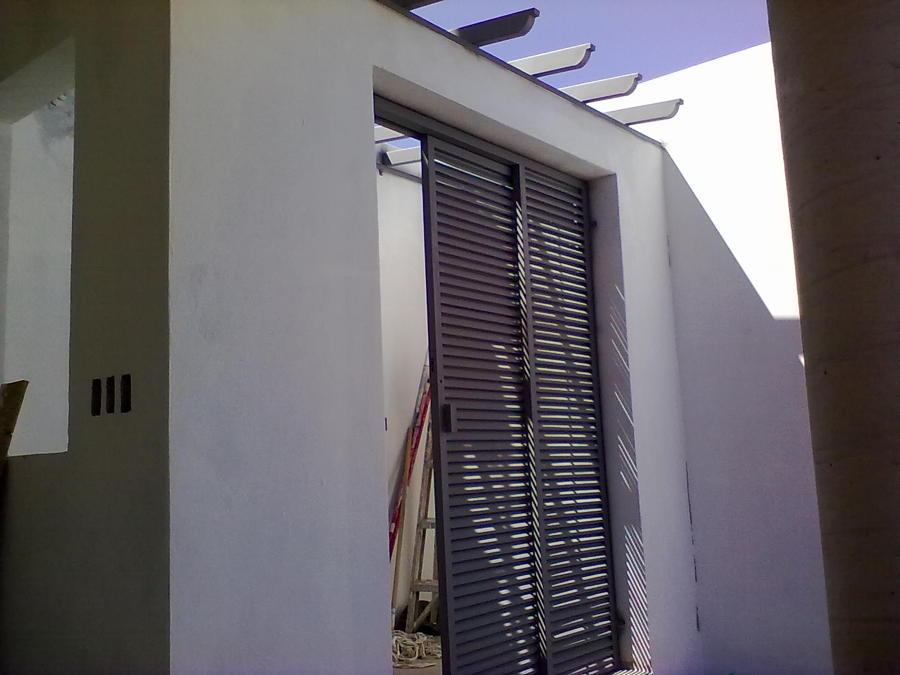 Foto puertas de servicio y tejabanes de herreria for Puertas minimalistas de herreria fotos