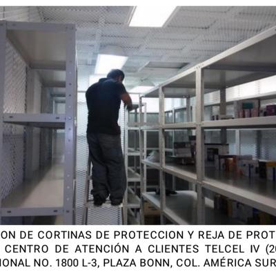 Colocación de Cortinas y reja de protección en centro de atención a clientes telcel cac IV