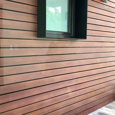 Fachada con aluminio tipo madera