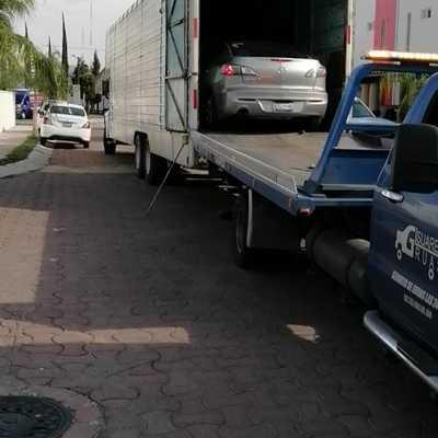 Traslados de vehículos sin rodar .