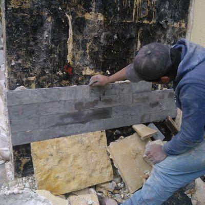 Colocación de Piedra en muro