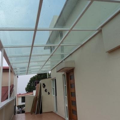 techado de herrería con cristal y película de seguridad