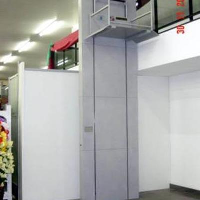 Elevador media cabina