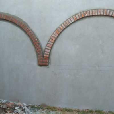 Arcos de ladrillo y aplanado