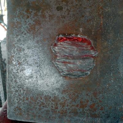 Probeta terminada (botón) unión placa- varilla para obtener la calificación de la habilidad del soldador para estructura metálica.