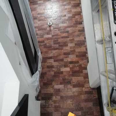 Colocación de loseta en muro de escaleras