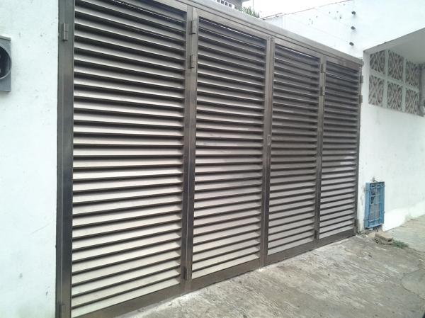 Foto puerta de garage plegable de aluminios de quintana - Puertas para garages ...