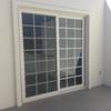 Instalación de toldos para proteger del sol dos ventanas de planta alta