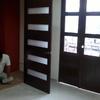 Colocacion de puerta de madera en exterior asi como pintura de la misma