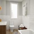 baño blanco con paredes de ladrillo