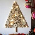 Árbol de Navidad de madera en la pared