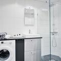 Baño pequeño con lavadora