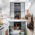 Doble fachada con aperturas