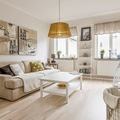 Sala estilo nórdico con piso laminado de madera