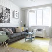 Sala amplia con pared de ladrillo visto blanca
