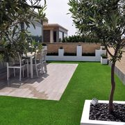 Terraza con piso de pasto sintético