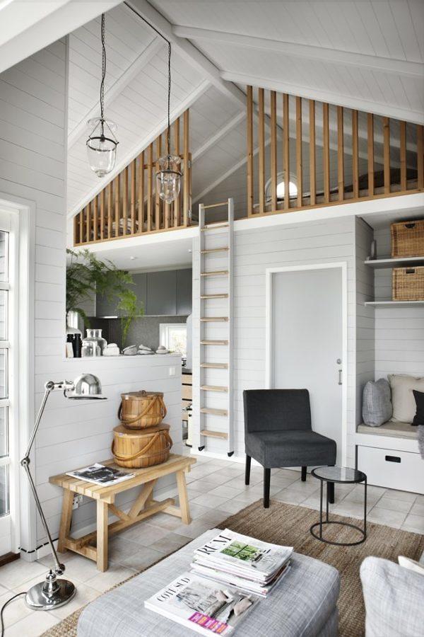 Sala estilo nórdico con ático y escalera