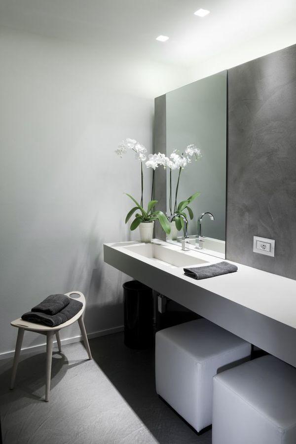 Baño con paredes y piso de microcemento