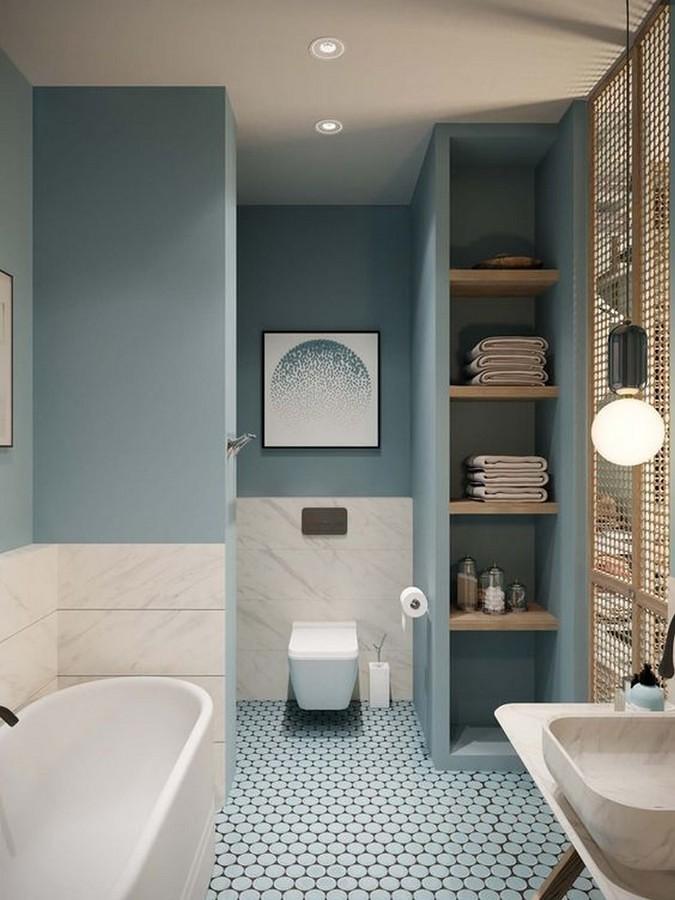 Baño en azul con suelo cerámico y azulejo en gris perla