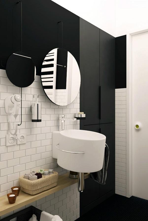 Baño pequeño decorado con colores blanco y negro