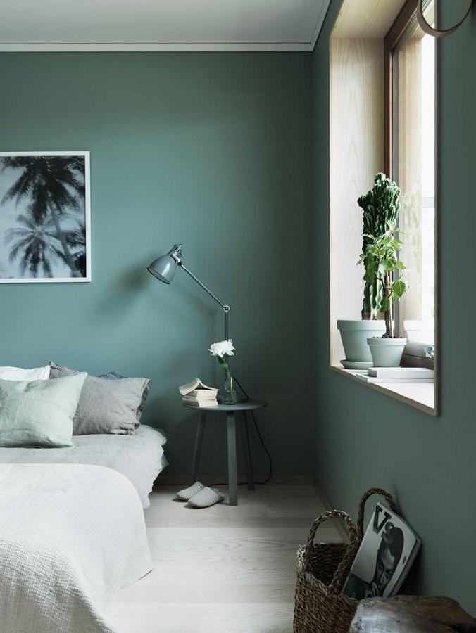 Recámara con paredes pintadas en verde