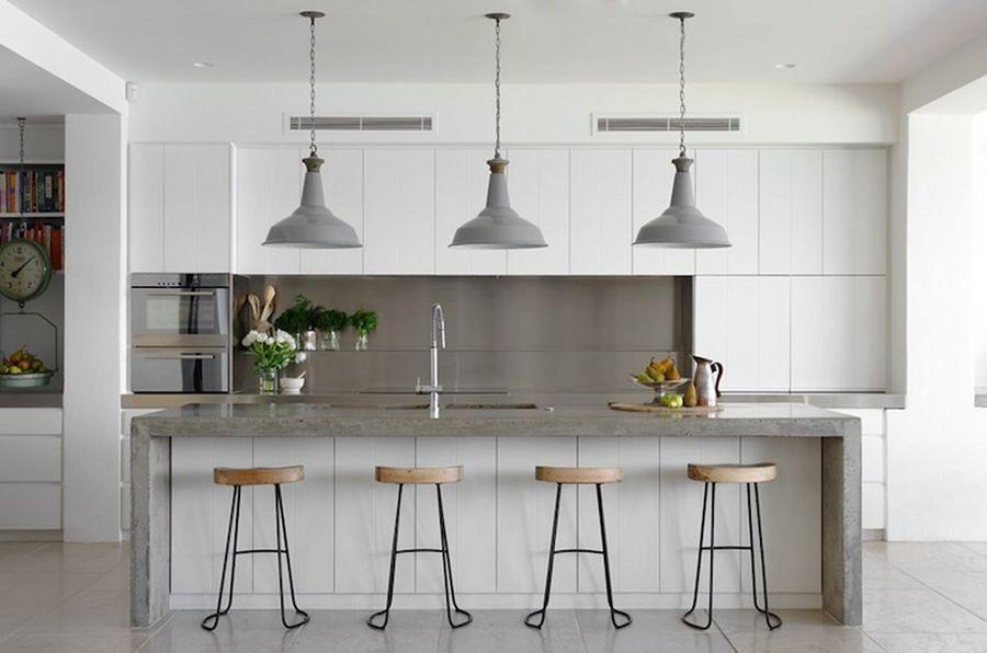 Cocina con azulejos de acero inoxidable