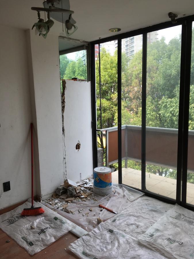 Demolición de muro divisorio.