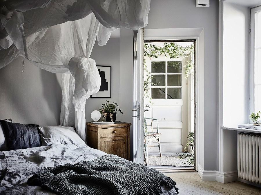 Recámara con paredes pintadas en gris