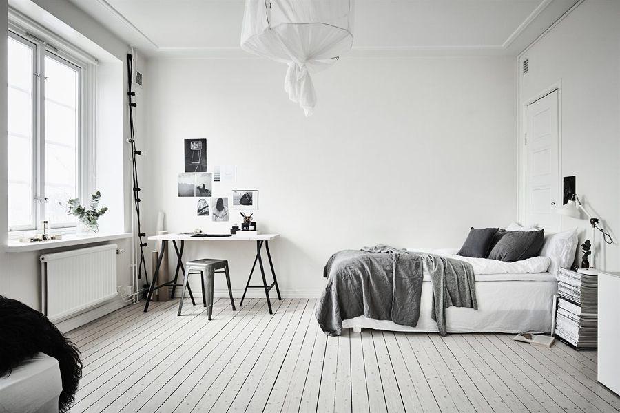 Recámara estilo nórdico con textiles en gris