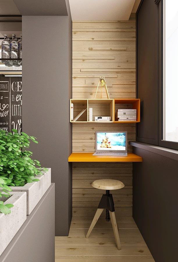 Departamento con escritorio pequeño y pared de madera