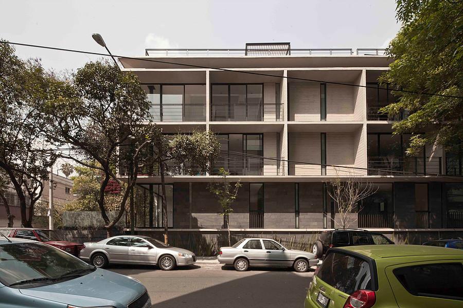 Fachada lateral con terrazas