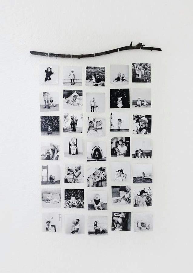 Fotografías en blanco y negro colgadas en la pared