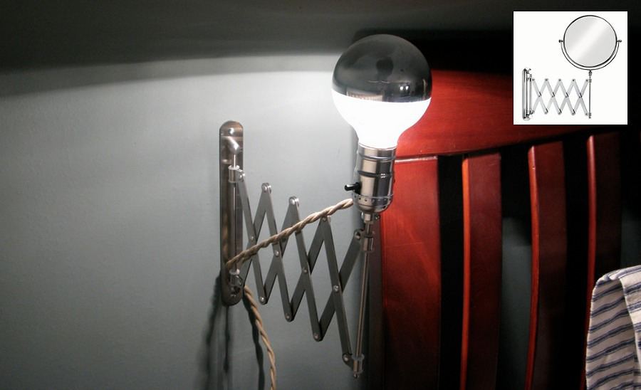 Brazo articulado con lámpara en la pared
