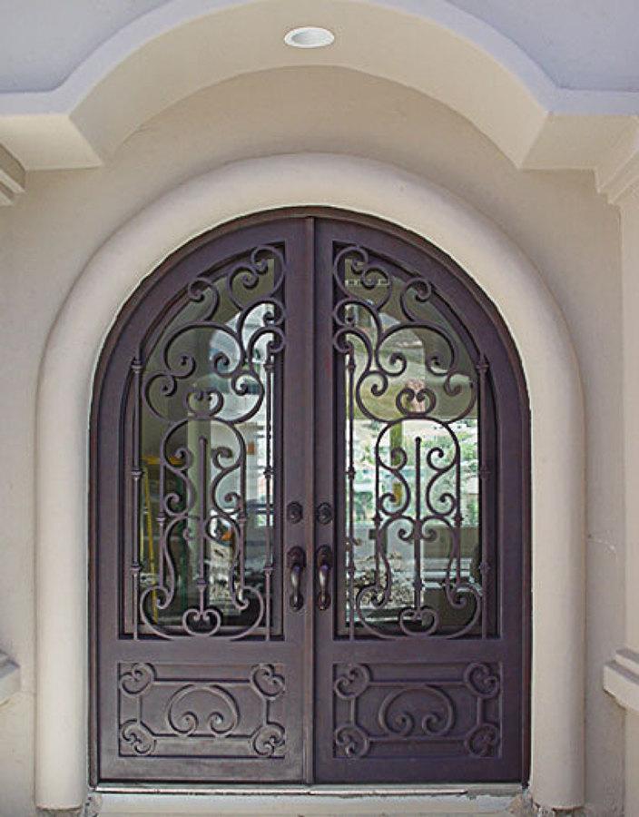 Puerta principal en forja ideas canceler a met lica for Puertas correderas de forja