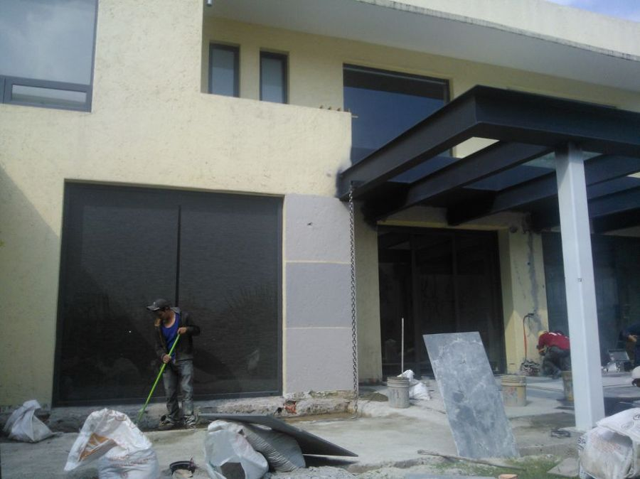 Remodelación de casa con pérgola