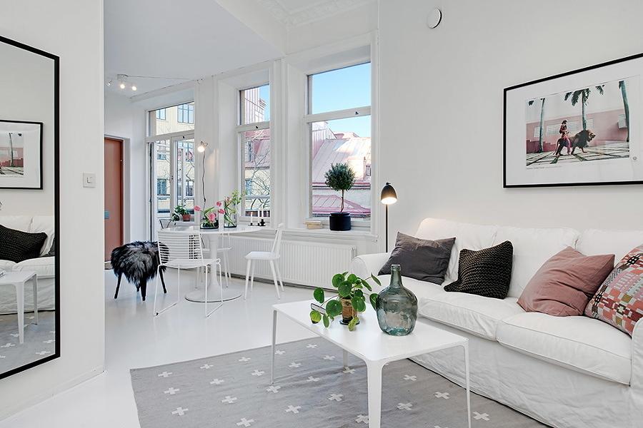 Sala estilo nórdico con piso de resina epóxica