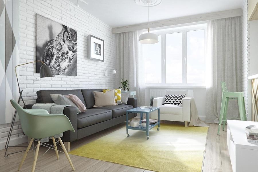 Sala luminosa con paredes de ladrillo blanco