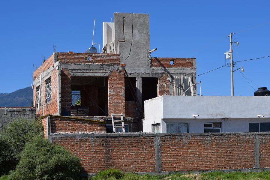 Vista lateral de la casa existente.