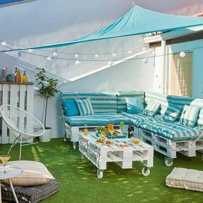Ideas para decorar tus exteriores con tarimas de madera