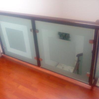 Cancelería en aluminio y vidrio templado