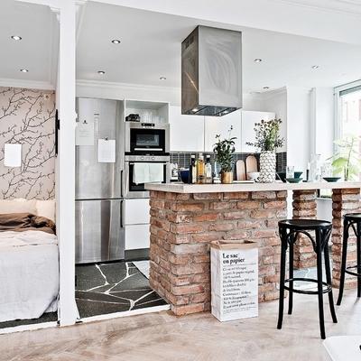 Cocina y recámara separadas por un muro