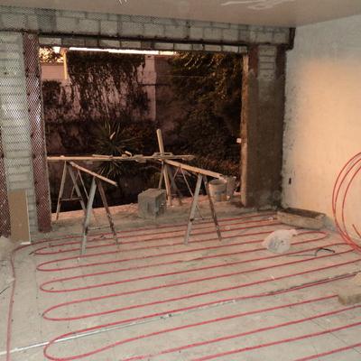Colocación de sistema de calefacción hidráulica en habitaciones